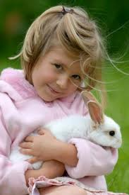 Girl and a pet rabbit