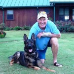 Terry Bradshaw and pet German Shepard